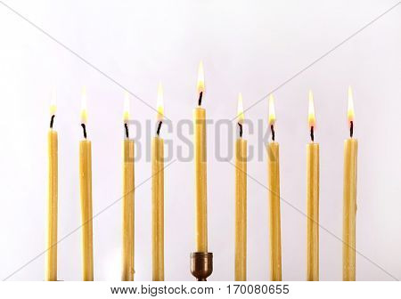 Menorah with candles for Hanukkah on light background, close up