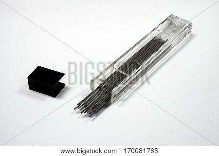 Black refill pen lead in the glass box