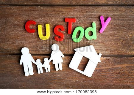 Word CUSTODY made of colorful letters on wooden background