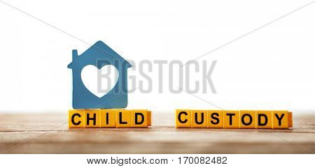Text CHILD CUSTODY made of yellow blocks  on table against white background, closeup
