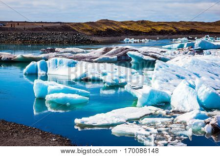 Northern nature. The concept of extreme northern tourism. White-blue ice is piled up in turquoise water of the lagoon. Drift ice Ice Lagoon - Jokulsarlon