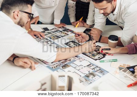 Team of architects working on construction plans.