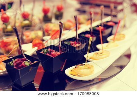 Various snacks on table, banquet food, toned image