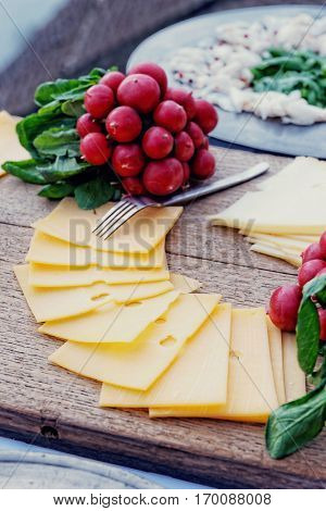 Rustic food on table - cheese, lard and vegetables