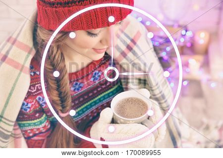 Time concept. Young woman with cup of coffee at home