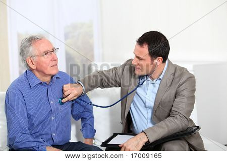 Doctor examining elderly man's health