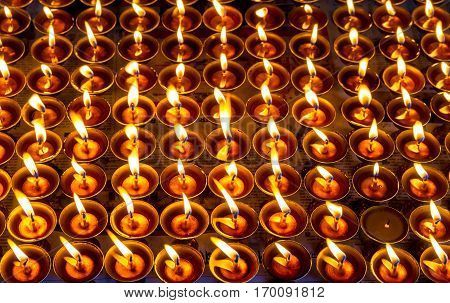 Butter Lamps burning at the religious place Swayambhunath in Nepal.