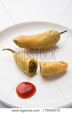 Stuffed Chilli Pakora or mirchi pakoda or mirchi vada, An extremely delicious and mouth watering snack of Pakistani & Indian People