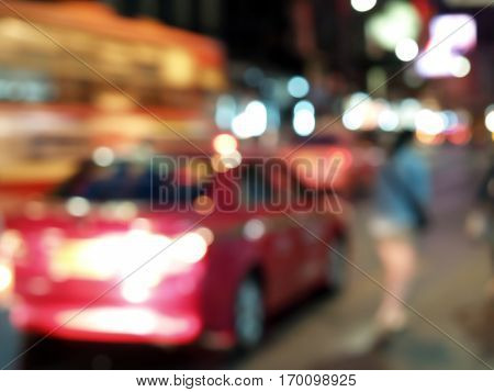 defocused colorful car lights, street lamp bokeh and people walking on roadside, blurred city life at night of Chinatown, Thailand