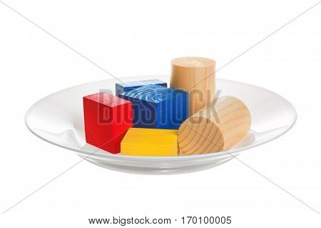 Genetically modified food. Plate with colored objects on a white background.