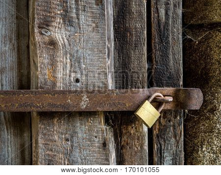 wooden wall as a background. blocked with bars