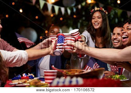 Friends Making A Toast To Celebrate 4th Of July Holiday