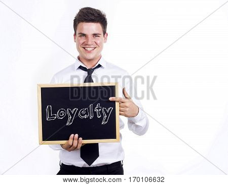 Loyalty - Young Smiling Businessman Holding Chalkboard With Text