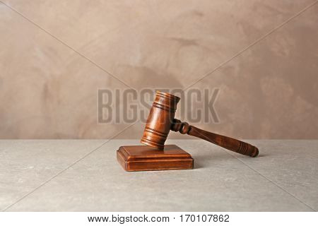 Judge gavel and soundboard on grey background