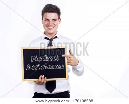Medical Assistance - Young Smiling Businessman Holding Chalkboard With Text