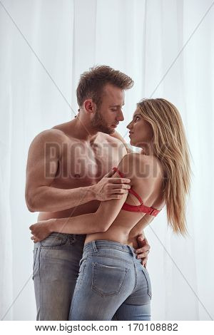 Man Undressing The Woman