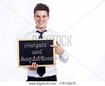 Mergers And Acquisitions - Young Smiling Businessman Holding Chalkboard With Text