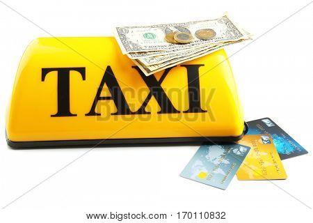 Yellow taxi roof sign with money and credit cards on white background, closeup