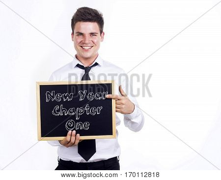 New Year Chapter One - Young Smiling Businessman Holding Chalkboard With Text