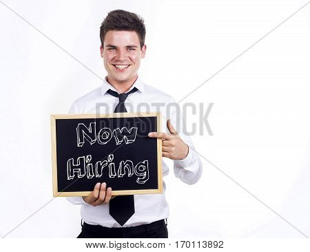 Now Hiring - Young Smiling Businessman Holding Chalkboard With Text