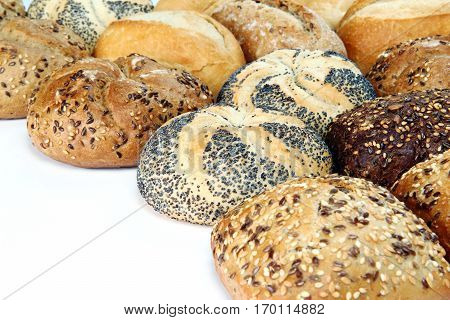 different kinds of buns on a white background