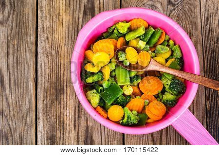 Mix of deep-frozen vegetables on plate. Studio Photo