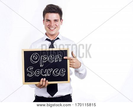 Open Source - Young Smiling Businessman Holding Chalkboard With Text