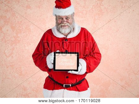 Portrait of santa claus holding a digital tablet with text marry xmass