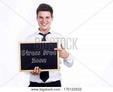 Stress Free Zone - Young Smiling Businessman Holding Chalkboard With Text