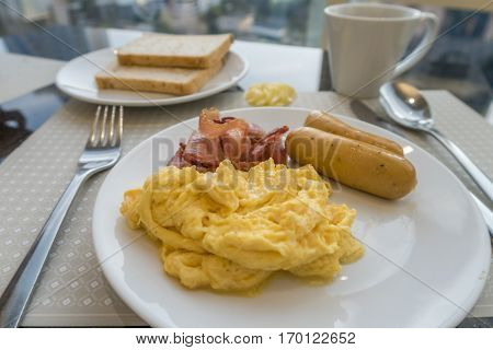 Breakfast With Scambled Eggs, Sausage And Bacon