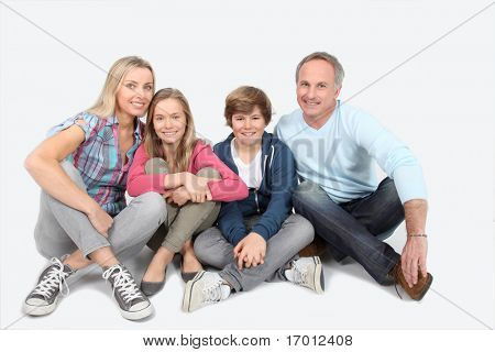 Happy smiling family sitting on white background