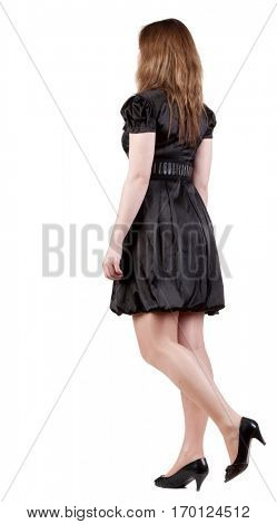back view of going blonde woman  in  black dress. beautiful going girl in motion.  backside view of person. Isolated over white background. Rear view people collection.