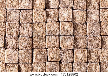square pieces of brown sugar top view