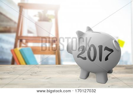 Digital image of new year 2017 against view of business stuffs on scale