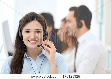 Female call center operator working in office