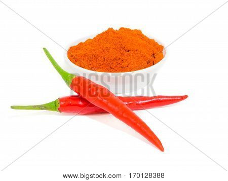 Fresh red juicy peppers and chili powder isolated on white background