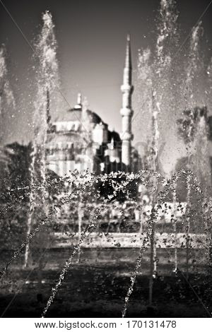 fountain with blue mosque in the background istanbul turkey