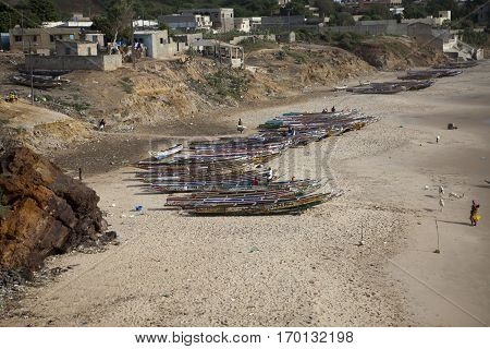 view on a beach with traditional Senegalese wooden boats Senegal