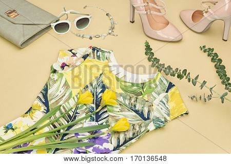 Fashion Design Spring girl clothes set, accessories. Trendy sunglasses, floral dress, fashion handbag clutch.Glamor shoes heels Summer lady. Creative urban. Pastel spring colors.Perspective view