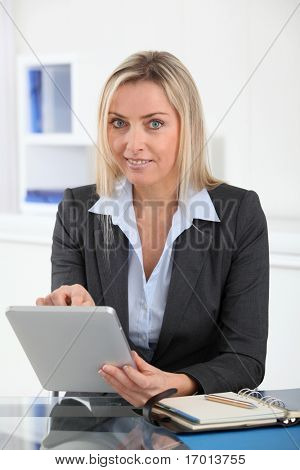 Businesswoman in the office with electronic tablet