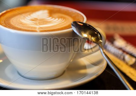 Cup of latte or cappuccino or mocha coffee in a cafe