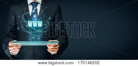 Internet websites and SEO concepts. Businessman hold futuristic tablet with head-up display and text www.
