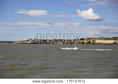 View of the coastline with seaside resort of Royan with blue sky and fluffy white cloud France