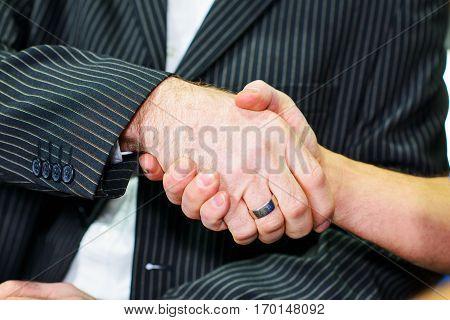 handshake- hands of boss and worker- wo mans