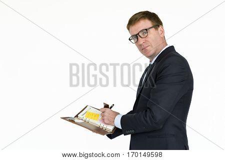 Businessman Writing Document Paperwork Concept