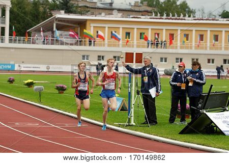 ZHUKOVSKY, MOSCOW REGION, RUSSIA - JUNE 27, 2014: Men compete in 2000 meters during Znamensky Memorial. The competitions is one of the European Athletics Outdoor Classic Meetings