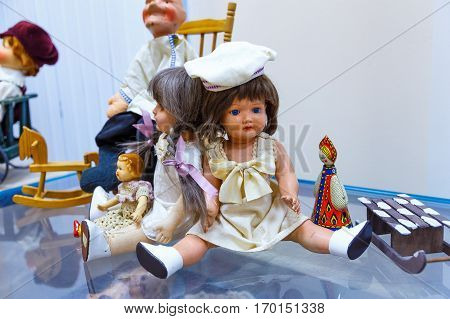 old vintage antique dolls at an art exhibition