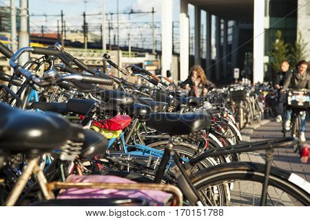 Bicycles parked together in a parking area