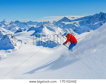 Skiing with amazing view of swiss famous mountains in beautiful winter snow. The matterhorn and the Dent d'Herens. In the background Castor and Pollux. In the foreground the Grand Desert glacier.