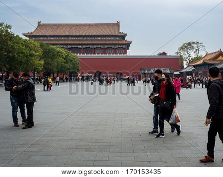 Beijing, China - Oct 30, 2016: Meridian Gate (Wumen) spacious courtyard area; the main gateway into the Forbidden City (Gu Gong, Palace Museum). Many visitors walking about.